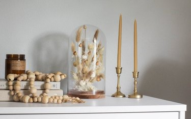 DIY fall decor idea with dried florals in cloche