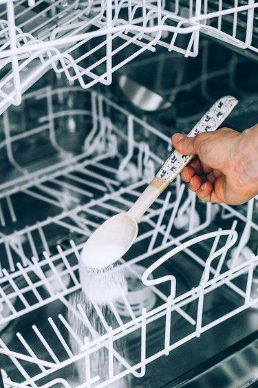Sprinkle baking soda to clean dishwasher