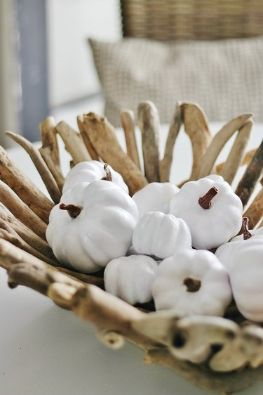 Coastal fall decor with driftwood bowl with white pumpkins