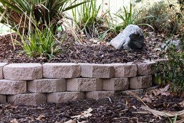 A garden retaining wall made of interlocking blocks