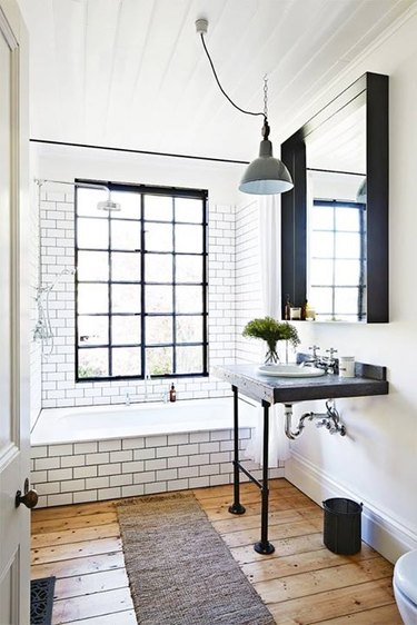 factory style pendant industrial bathroom light fixture in white and black bathroom
