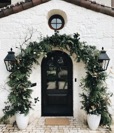 Floral Christmas garland with Christmas yard decorations