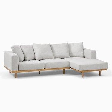 modern coastal sofa with wood base by West Elm