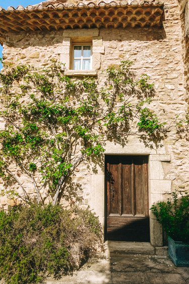 French country exterior made of stone with wooden door