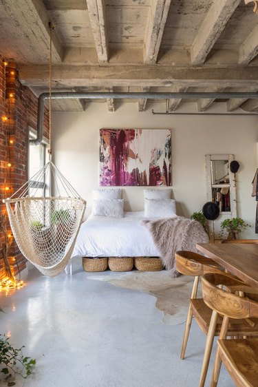 industrial bedroom with exposed concrete ceiling beams