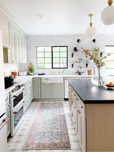 porcelain kitchen floor tile with light green cabinets and white countertops