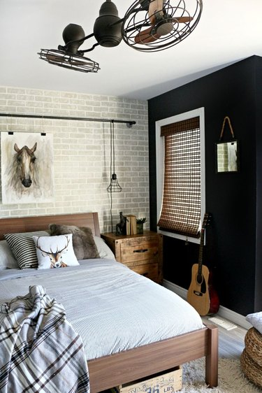 industrial bedroom with black wall and rustic accents