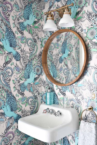 turquoise and white removable bathroom wallpaper print with bird pattern and wall-mounted sink