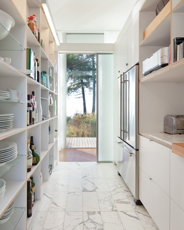 Galley kitchen flooring idea with marble tile