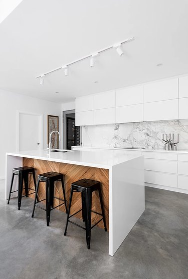 Contemporary Modern kitchen flooring idea with concrete and white cabinets