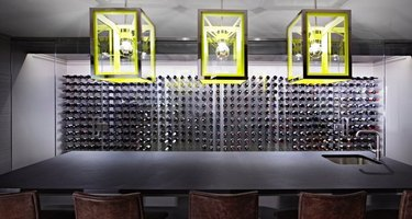 basement ideas in Gray and black basement bar with lime green matching pendant lights.