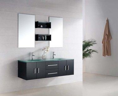 glass bathroom countertop on wall-mounted black vanity cabinet