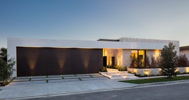 Exterior Garage Lighting on modern home exterior with split black garage