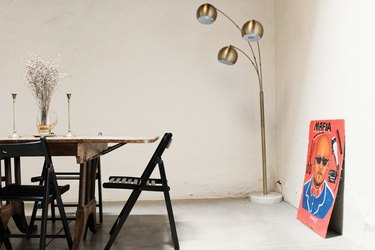 Vintage floor lamp in dining area.