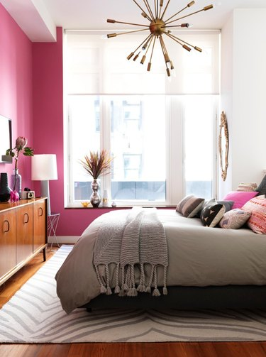 hot pink bedroom with glam chandelier