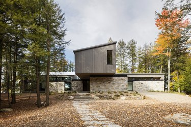 boxy modern house with trees nearby
