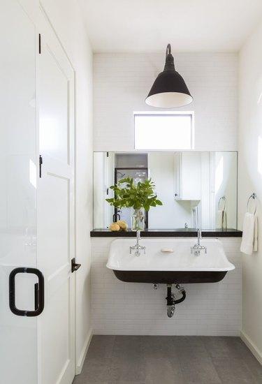 modern farmhouse trough sink black and white bathroom