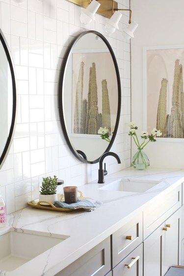 thin marble style quartz bathroom countertop on gray vanity cabinet