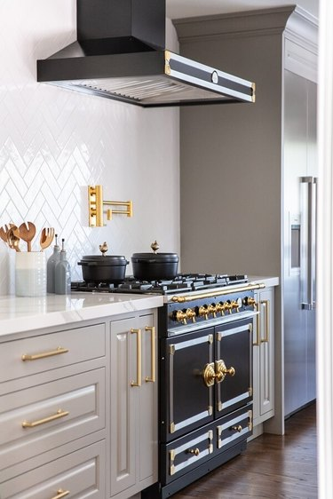 gray and black kitchen color scheme with gray cabinets and white backsplash