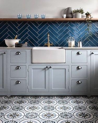 ceramic kitchen floor tile with blue backsplash and open shelving