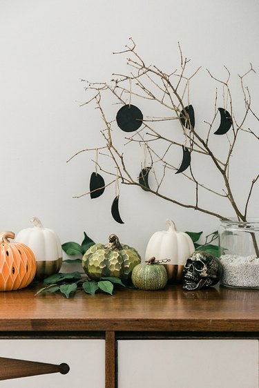 Place a found tree branch in a jar filled with rocks to create your Halloween centerpiece.