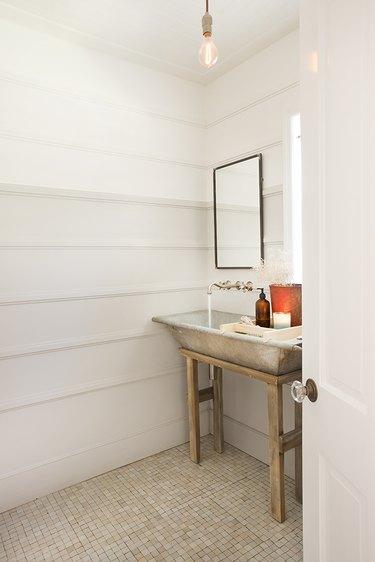 rustic bathroom with repurposed trough sink