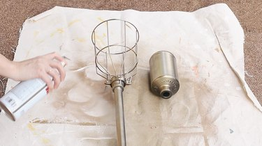 Spray painting torch and bottle brass
