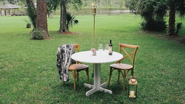 Brass pipe torch in front of outdoor table
