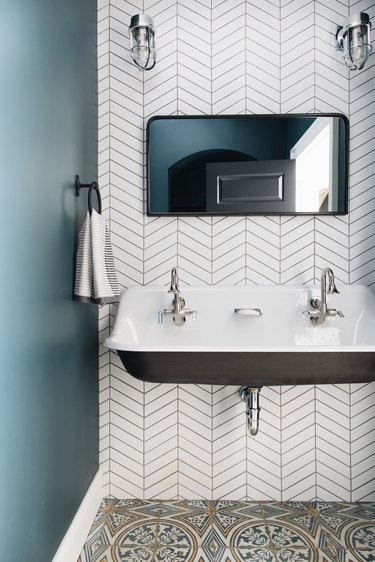 trough bathroom sink with with white herringbone wall tile