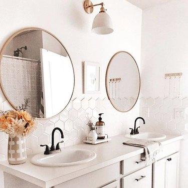 double vanity unit with self-rimming bathroom sinks and hexagonal backsplash tile