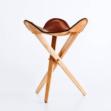 folding tripod accent stool with leather seat