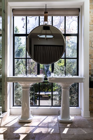 Bathroom in front of window with two sinks and hanging window.