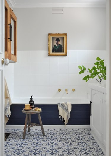 small bathtub with blue surround in modern traditional space