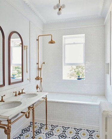 narrow art deco bathroom with small bathtub shower combo