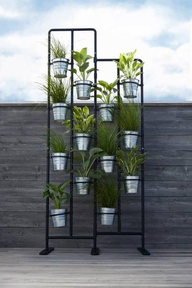 room divider idea for the living room with plants