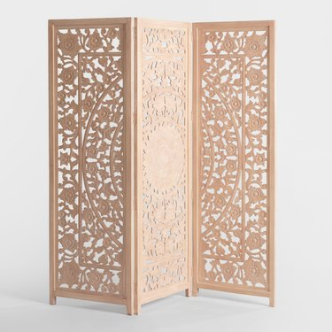 room divider idea for the living room with handcarved floral motif in folding screen
