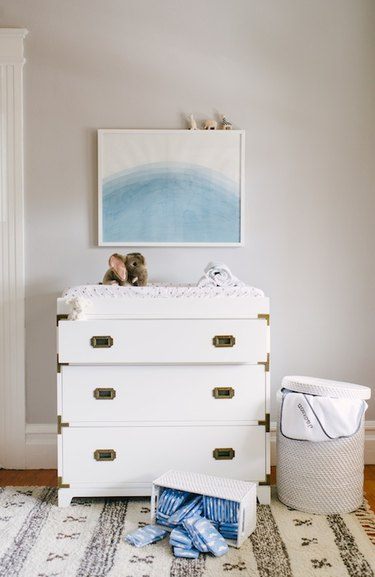 nautical themed nursery with chest of drawers as changing table