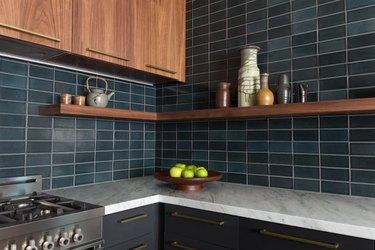 dark blue-green fire clay tile backsplash in modern kitchen