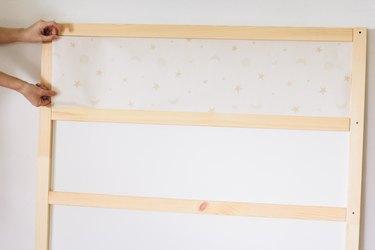 Taping wallpaper to KURA bed panels