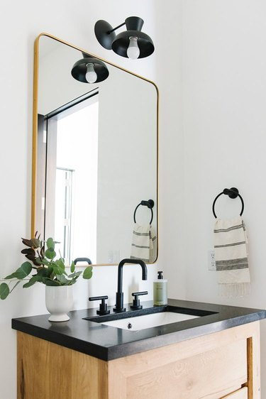 black quartz bathroom countertop with wood vanity cabinet