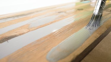 Streaking with gray wood stain for weathered wood finish.