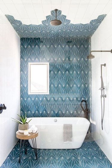 blue patterned bathroom with open shower
