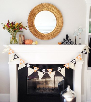 White mantle with black surround and farmhouse fall decor