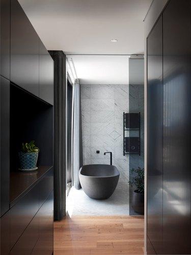 dark bathroom with black bathroom fittings
