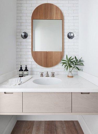 white boho space with undermount bathroom sink and floating vanity and subway tile backsplash