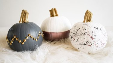 showing three no-carve pumpkins with various paint effects