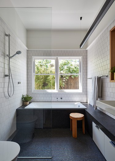 polished chrome bathroom fittings with white subway tile on walls