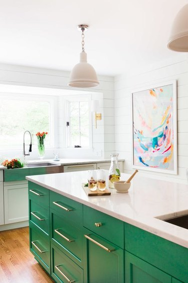 kitchen island with green cabinets