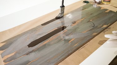 Streaking with brown wood stain for weathered wood finish.