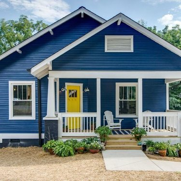 yellow and navy blue home exterior with white trim